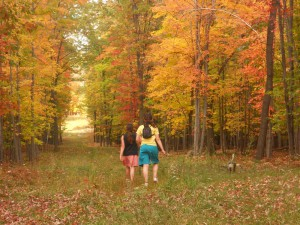 The girls enjoy the autumn colors.